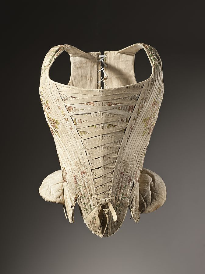 "Woman's corset, figured silk, 1730-1740. Described as being ""Silk plain-weave with supplementary weft float patterning stiffened with baleen"" it appears courtesy of the Los Angeles County Museum of Art."